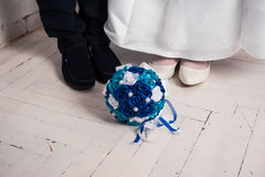 Blue wedding bouquet and wedding rings on a pillow. Wedding, bouquet, pillow, flower, ring, blue, decoration, floor, white, board, cloth, Blue wedding bouquet Stock Images