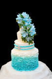 Blue wedding cake on a black background Royalty Free Stock Photos