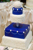 Blue wedding cake decorated with flowers Stock Images