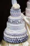 Blue wedding cake decorated with flowers royalty free stock photos
