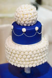 Blue wedding cake decorated with flowers Royalty Free Stock Images