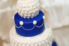 Blue wedding cake decorated with flowers Royalty Free Stock Photo
