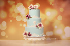 Blue wedding cake with roses Stock Images