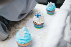 Blue wedding cup cakes on table Royalty Free Stock Images