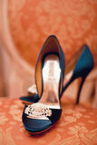 Blue wedding shoes. With brooch Stock Photography