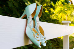 Blue Wedding Shoes on Fence Stock Images