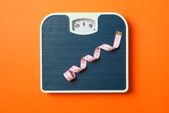 Free Blue Weigh Scales With Measuring Tape On Orange Background Stock Photography - 154195902