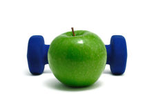 Blue Weight and Green Apple Stock Images