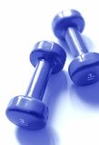 Blue weights. A pair of 3 kg weights, blue toned Stock Images