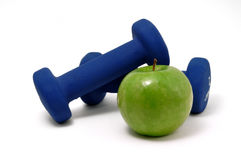 Blue Weights and Green Apple Royalty Free Stock Images