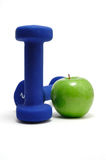 Blue Weights and Green Apple Stock Images