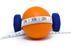 Blue Weights, Orange, and Tape Measure. Isolated on a white background Royalty Free Stock Photo