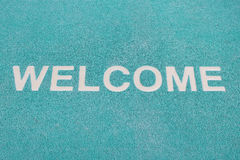 Blue welcome carpet, welcome doormat carpet Stock Image