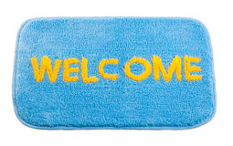 Blue welcome doormat. Soft and cozy texture welcome doormat beautiful and useful for shoes cleaning Stock Photography