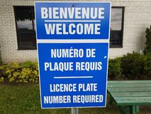 Blue welcome license plate number required in French and English stock photos