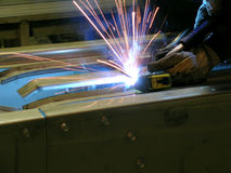 Blue Welding. Close up of an individual welding a stainless steel assembly Stock Images