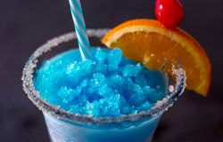 Blue whale drink close up. Close up of a delicious frozen drink called a blue whale, with ice, lemonade, citrus vodka and curacao blue royalty free stock photos