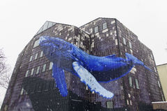Blue Whale flying through a building. ZAGREB, CROATIA - JANUARY 2016 Blue Whale flying through a building royalty free stock photography