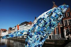 Blue whale plastic statue. Huge statue of a blue whale made out of plastic waste, to be seen in the city of Bruges, Belgium royalty free stock images