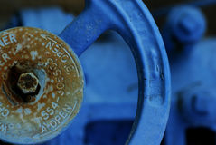 Blue wheel. Wheel used to open water channels at a waterworks Stock Images