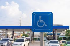 Blue wheel chair sign in gas station royalty free stock photography