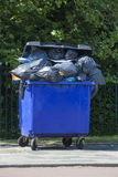 Blue wheeled garbage can Royalty Free Stock Image