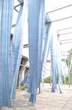 Blue and White. Blue fabric on bamboo stick royalty free stock photo