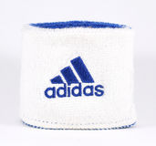 Blue and white Adidas wristband - isolated Stock Photo