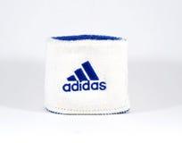 Blue and white Adidas wristband - isolated Royalty Free Stock Photos