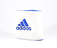 Blue and white Adidas wristband - isolated Royalty Free Stock Images