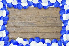 Blue and white air balloon. In front of a wood background stock images
