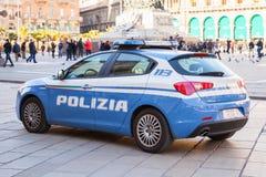 Blue and white Alfa Romeo Giulietta, police royalty free stock photos