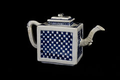 Blue and White Antique Chinese Teapot on Black Background Royalty Free Stock Photography
