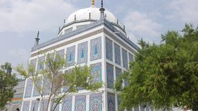 blue and white architect shrine of shah abdul latif bhitai in sindh beautiful in morning stock photography