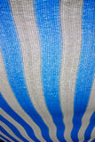 Blue and white awning. Awning of plastic material - blue and white canvas for shade royalty free stock photos