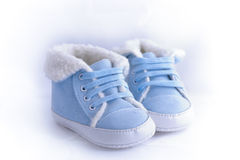 Blue and white baby shoes Stock Image