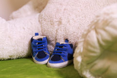 Blue and white baby shoes. Stock Images