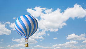 Blue-white balloon. In the blue sky Royalty Free Stock Photo
