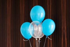 Blue and white balloons on brown wooden background royalty free stock photos