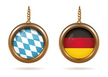 Blue-white Bavarian flag and German tricolor. Golden medallions set with the Bavarian and German flag inside. Blue-white checkered Bavarian flag and German Stock Photo