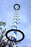 Blue and white Bavarian maypole on blue sky Royalty Free Stock Image