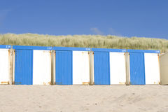 Blue and white beach cabins Stock Photography