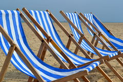 Blue/White Beach Chairs. Close up of blue and white striped beach chairs Royalty Free Stock Photography