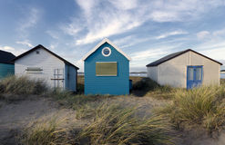 Blue & White Beach Huts. Beach huts in sand dunes at Mudeford Spit on Hengistbury Head near Christchurch in Dorset Stock Images