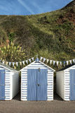 Blue and White Beach Huts at Seaton, Devon, UK. A set of blue and white painted beach huts at Seaton, Devon, UK Royalty Free Stock Images