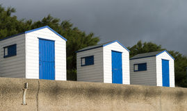 Blue and White Beach Huts at Southwold, Suffolk, U. A row of blue and white beach huts at Southwold, Suffolk, UK Stock Images
