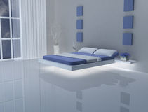 Blue and white bedroom, bed without legs Stock Photography