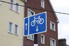 Blue and white Bicycle Cycle lane city sign. With apartment block on a background royalty free stock images