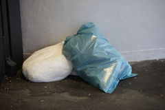 Blue white bin bag laying bottom Royalty Free Stock Image