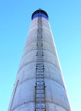 Blue, White and Black Chimney with Ladder Stock Images
